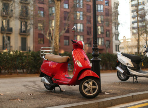 52013602 - red moped in barcelona